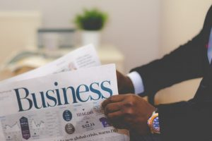 photo - business person reading paper