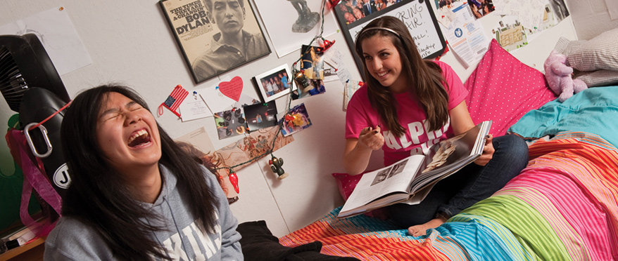 Students laughing in dorm room