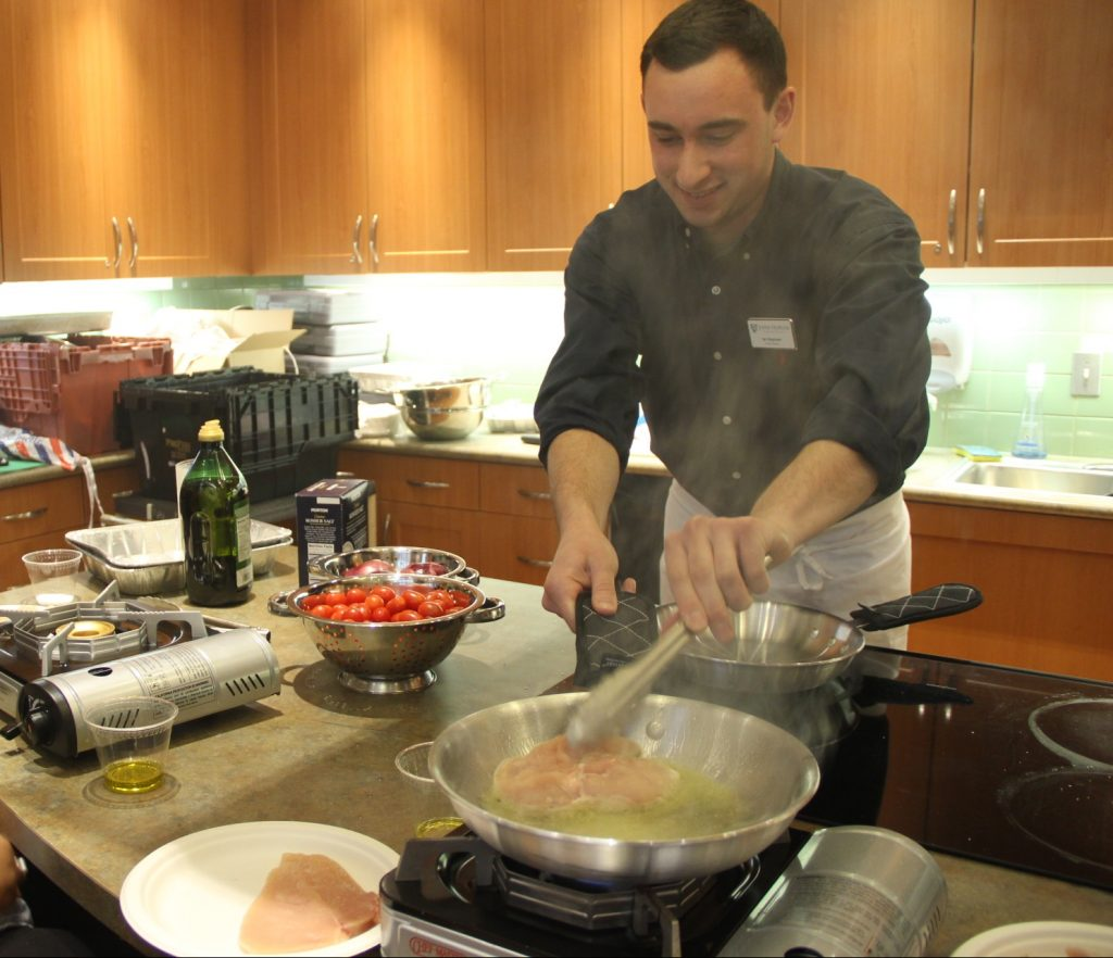 Chef Magowen prepares a dish