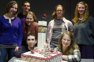 Students standing next to their gingerbread Bromo Seltzer Tower construction