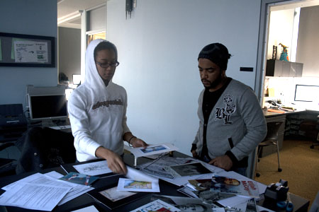 "Two students work on ""Roots of American Innovation"" digital prints in the DMC"