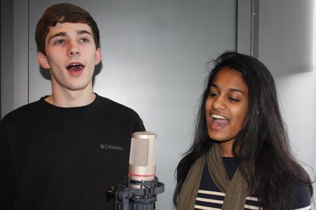 "Singers Josh Temple and Meera Valliath sing ""I See the Light"" in the DMC recording studio"