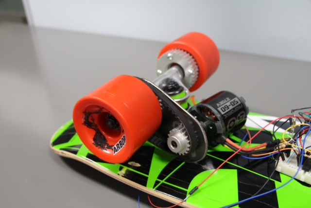Detail view of Electric Skateboard motor and wheels