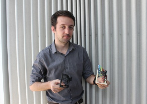 Frederic Vogt hold 3d prints of galaxy graphs