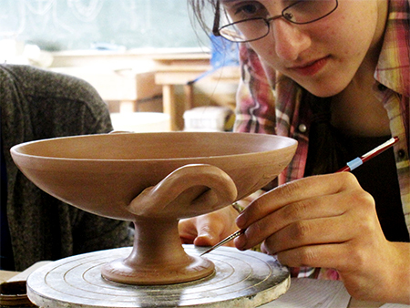 Anna Soifer working on pottery