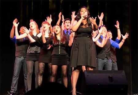 Lajari Anne performing on stage with singing group