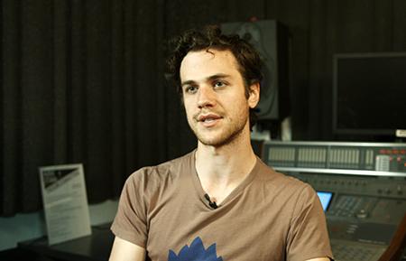 Portrait of Max Bowens in DMC Audio Studio