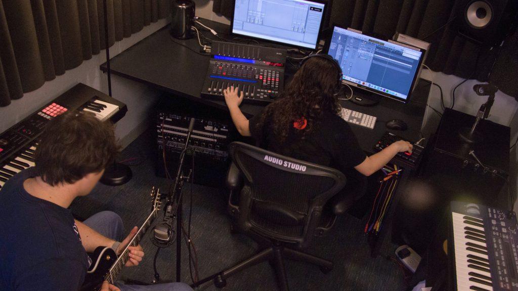 Students recording music in the DMC audio studio