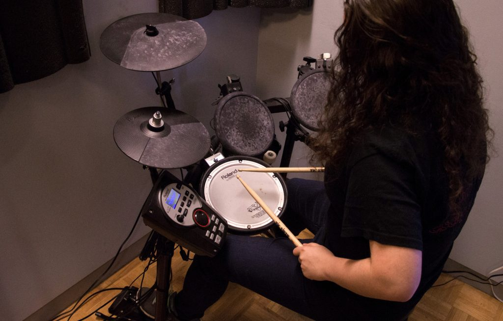 Student using the electronic drums