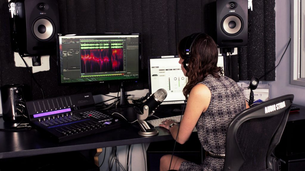 Student mixing music in the Audio Studio