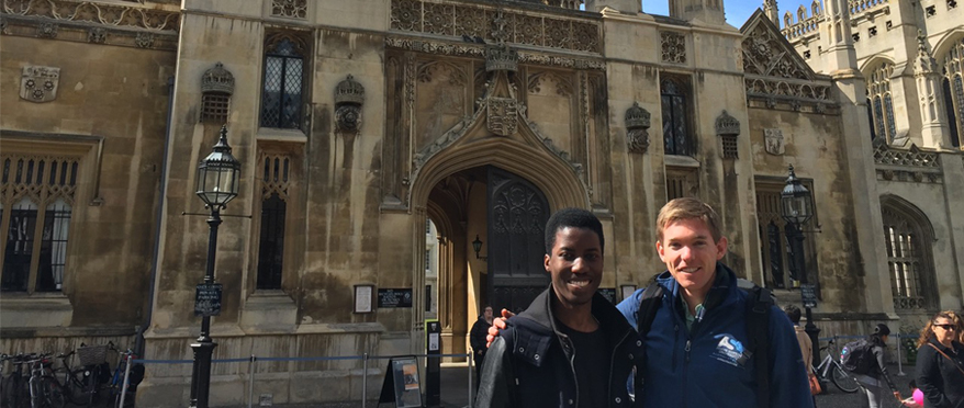 Students pose in front of church in Cambridge