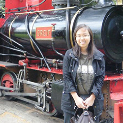 Alane in front of a train