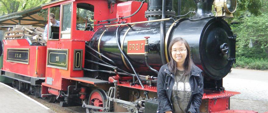 Alane posing in front of a train