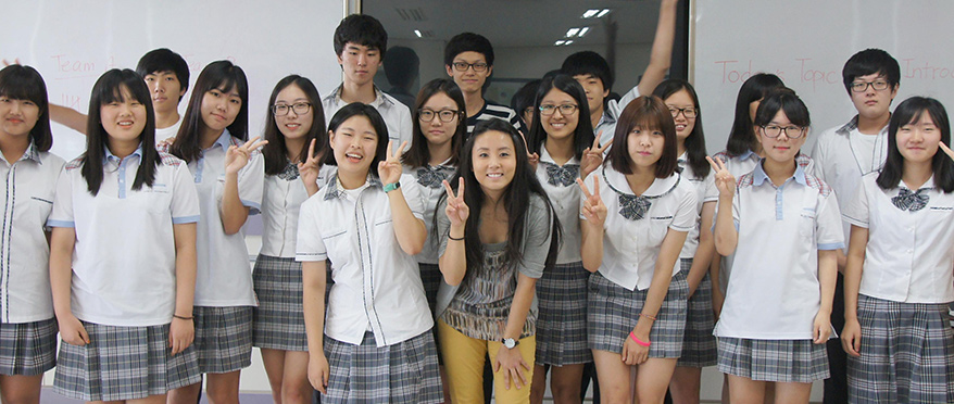 Mary posing with group of students