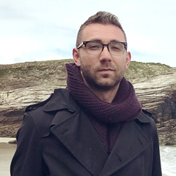 Ben standing on beach
