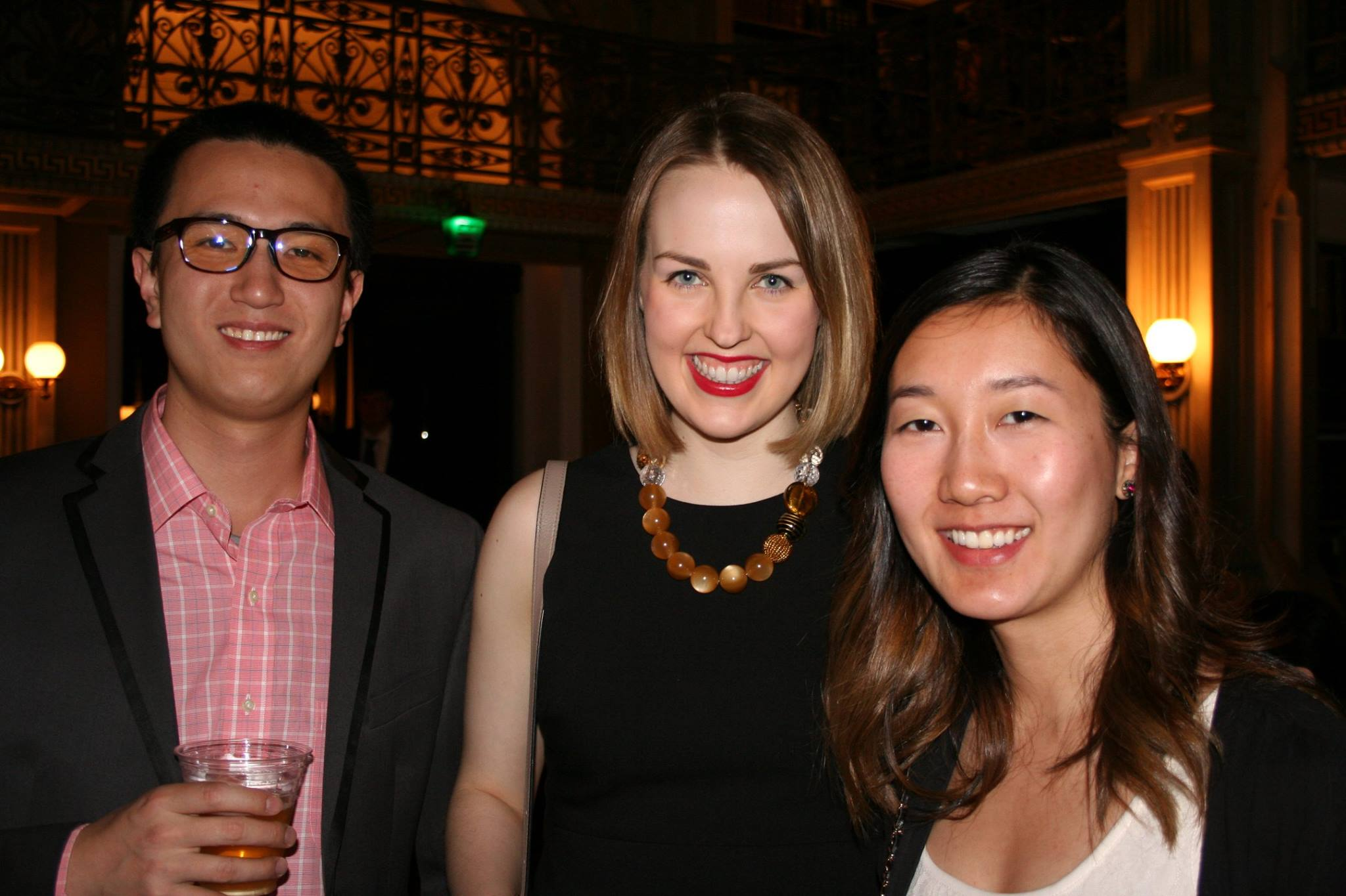 group picture of students at cocktail night smiling