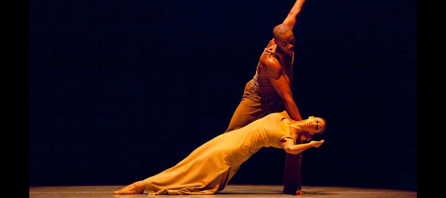 Dance partners from an elegant scene in Alvin Ailey Dance.
