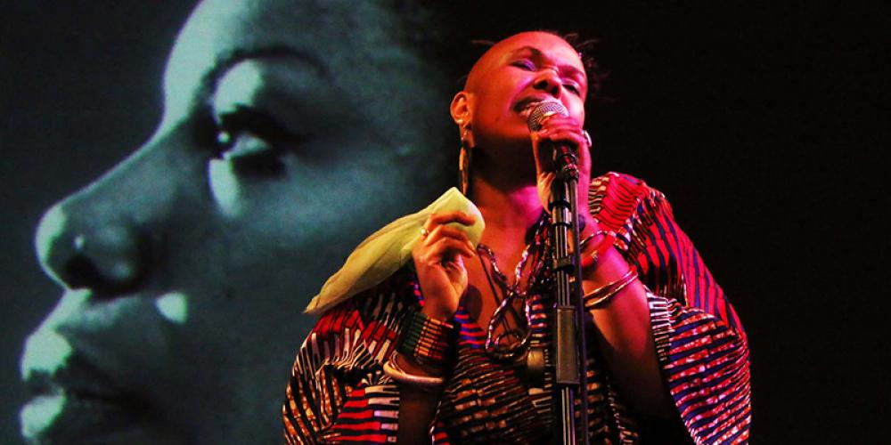 Singer performing on stage.