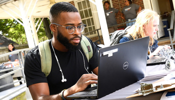 Student registering on laptop