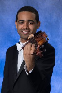 Jordan Elum holding violin.