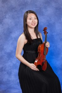 Alice Huang holding violin.