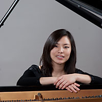 A head shot of Hyun-Sun Seo sitting at a piano.