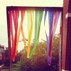 Rainbow-colored ribbons hanging in the air.