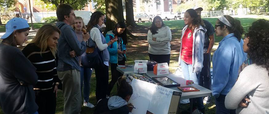 Students staffing a booth on campus