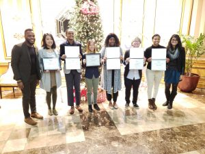 Students holding up Leadership Award certificates