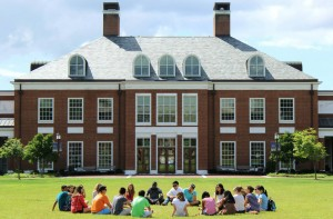 Students sitting in a circle in front of Mason Hall