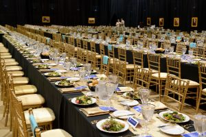 rows of tables set for High Table