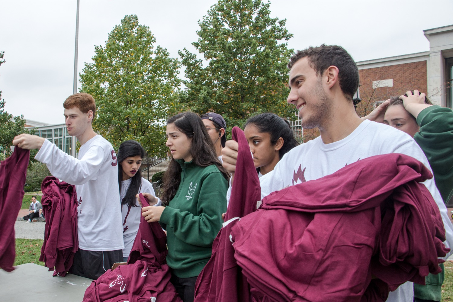Students handing out t-shirts