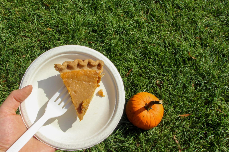 Holding pumpkin pie.