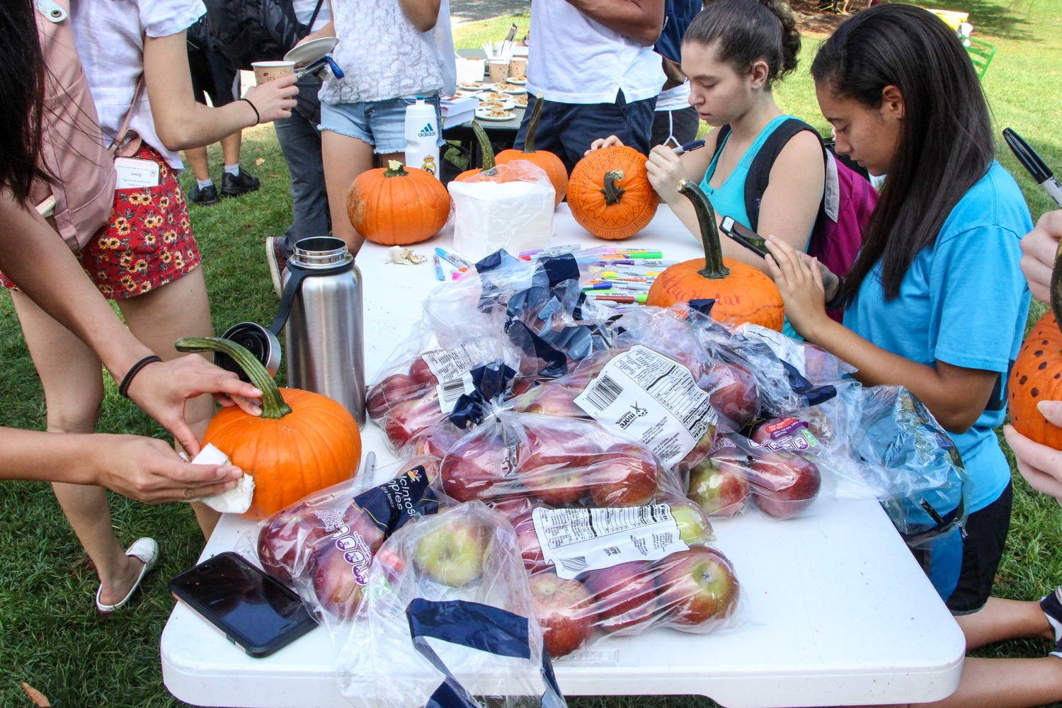 Students decorating their pumpkins.