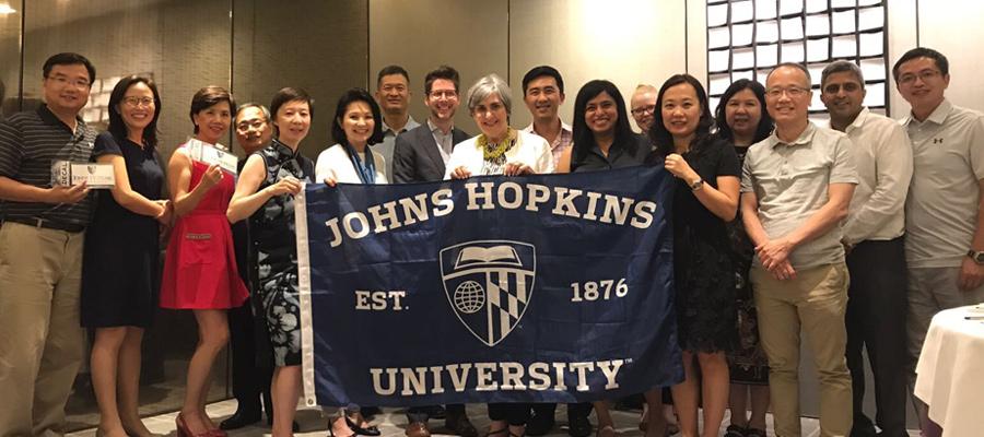 Hong Kong Parents Council holding JHU flag