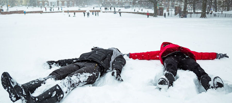 Two students making snow angels.