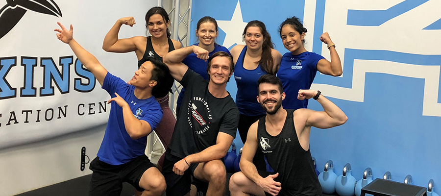 F45 trainers flexing muscles