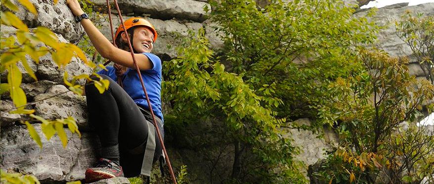 Girl smiles while climbing