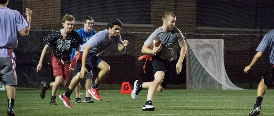 Students playing flag football.