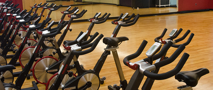 Stationary bikes in the gym room.
