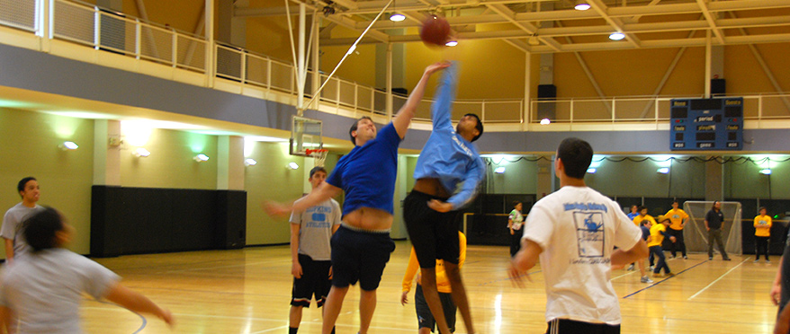 Two players jumping during a basketball game.