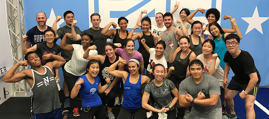 F45 class flexing their muscles