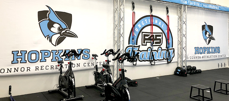 F45 equipment with logos on wall