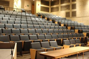 Empty classroom showing theater stadium seating.