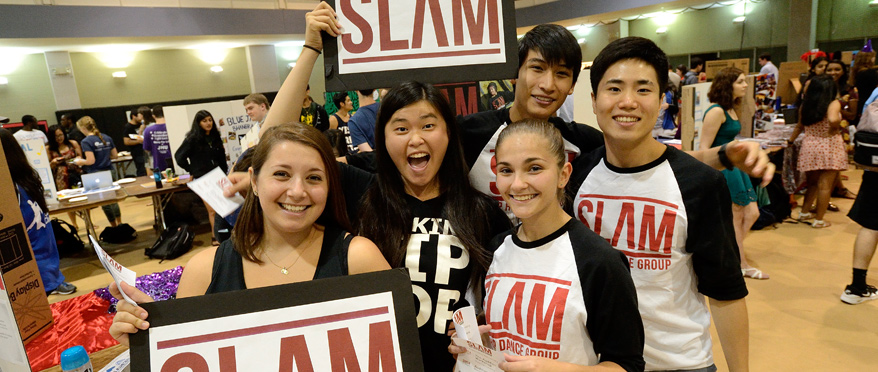 Students holding up signs during Student Involvement Fair.