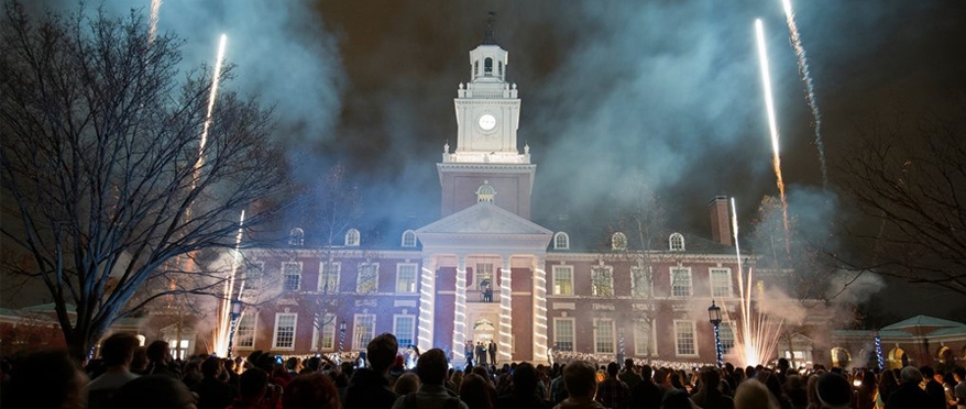 Fireworks over Gilman Hall during Lighting of the Quad