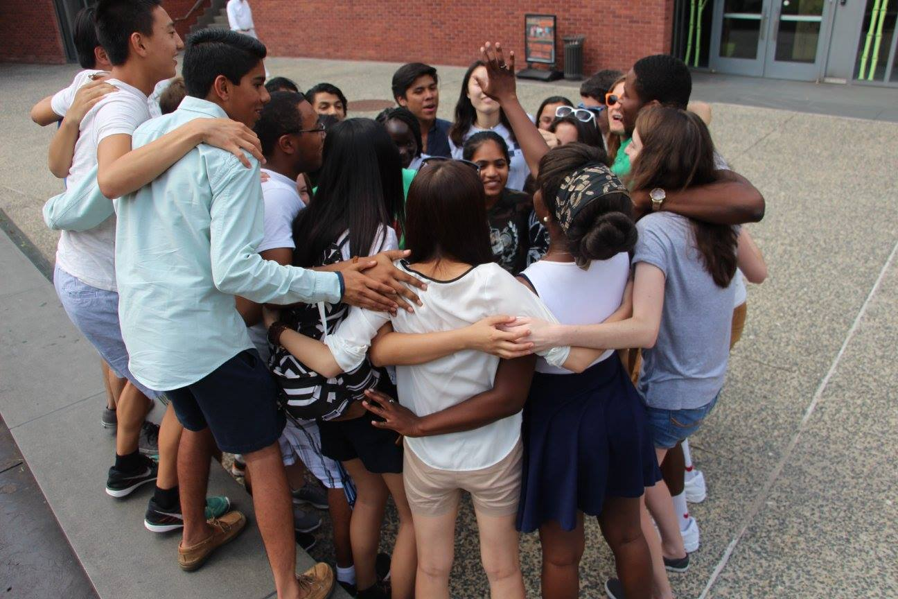 Students participating in a leadership program share a group hug. Students can nominate their peers for student leadership awards.
