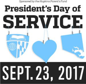 president's day of service sign with 9/23/17 and sponsored by the Hopkins Parent's Fund