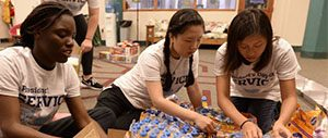 picture of students at PDOS sorting drinks for distribution
