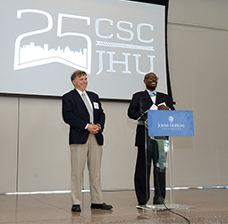 picture of Vinny DeMarco and Eric Anderson speaking during 25th anniversary event